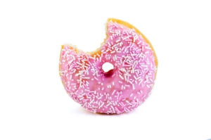 pink doughnut with a bite taken out isolated on white